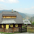Village With Wooden Houses On Mountain by Goce Risteski