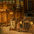 Vintage Auto Repair Garage With Truck And Signs by Design Turnpike