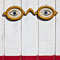 Vintage Eye Sign On Wooden Wall by Garry Gay