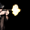 Vintage Gangster Man Shooting Gun On Black by Jorgo Photography - Wall Art Gallery