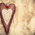 Vintage Handmade Plush Heart Pillow On The Soft Blanket by Michal Bednarek