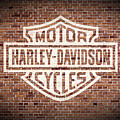 Vintage Harley Davidson Logo Painted On Old Brick Wall by Design Turnpike