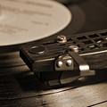 Vinyl Record Playing On A Turntable In Sepia by Angelo DeVal