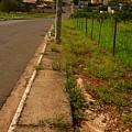 Walking On The Curb by Beto Machado