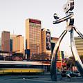Walking Tall Traveling Man - Dallas Texas Skyline by Gregory Ballos