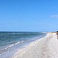 Walking The Beach At Sanibel. by Janette Boyd