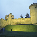 Warwick Castle At Dawn With A Man by Richard Nowitz