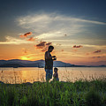 Watching Sunset With Daddy by Michelle Meenawong