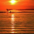 Water Skiing At Sunrise  by Lyle Crump