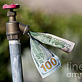 Water Spigot With Money Flowing Out by William H. Mullins