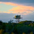 Water Tower In Orange Sunset by Miroslava Jurcik