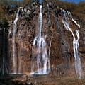 Waterfall And A Rainbow by Jaroslaw Blaminsky