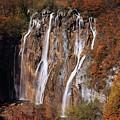 Waterfall In Autumn Scenery by Jaroslaw Blaminsky