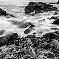 Waves Against A Rocky Shore In Bw by Doug Camara