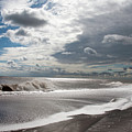 Waves Breaking Against The Beach And Cloud Streaming Above  Skegness Lincolnshire England by Michael Walters