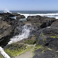 Waves Crash Ashore On A Lava Bed by John Trax