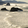 Waves Roll Ashore On The Oregon Coast by John Trax