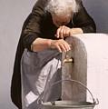 Weary Elderly Woman In Greece by Carl Purcell