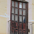 Weathered Red Door On A Balcony by Robert Hamm