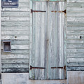 Weathered Wooden Door In France by Joe Maggio