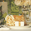 Wedding Party Favors On Plate At Reception by Sandra Cunningham