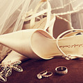 Wedding Shoes With Veil And Rings On Velvet Chair by Sandra Cunningham