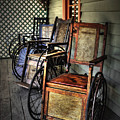 Wheelchairs Of Yesteryear By Kaye Menner by Kaye Menner