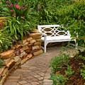 White Bench In The Garden by Rosalie Scanlon