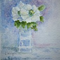 White Blooms In Blue Vase by Laurie Morgan