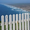 White Fence And Waves by Bruce Chevillat
