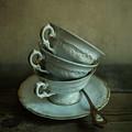 White Ornamented Teacups by Jaroslaw Blaminsky