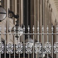 White Wrought Iron Gate In Chicago by Colleen Cornelius