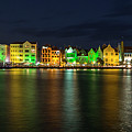 Willemstad And Queen Emma Bridge At Night by Adam Romanowicz