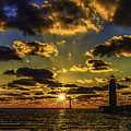 Winter Sunset At Muskegon Channel Light by Nick Zelinsky