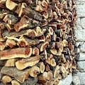 Winter Woodpile by Paul Cowan