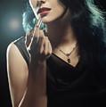 Woman Applying Lipstick by Amanda Elwell
