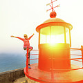 Woman At Nazare Lighthouse by Benny Marty