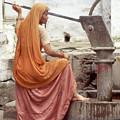 Woman At The Pump by Dray Van Beeck
