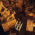 Woman Burning Candle At Troglodyte Sainte-marie Madeleine Holy Cave by Sami Sarkis