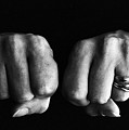 Woman Clenching Two Hands Into Fists In A Fit Of Aggression by Sami Sarkis