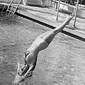 Woman Doing A Back Dive by Underwood Archives