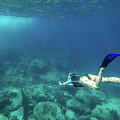 Woman Free Diving by Benny Marty
