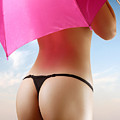 Woman In Bikini With A Pink Umbrella by Oleksiy Maksymenko