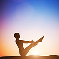 Woman In Full Boat Yoga Meditating At Sunset by Michal Bednarek