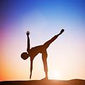 Woman In Half Moon Yoga Pose Meditating At Sunset by Michal Bednarek