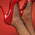 Woman In Red High Heel Shoes by Oleksiy Maksymenko
