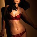 Woman In Red Lingerie by Oleksiy Maksymenko