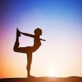Woman In The Dancer Yoga Pose Meditating At Sunset by Michal Bednarek
