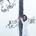 Woman In White Dress Hugging A Tree by Awen Fine Art Prints