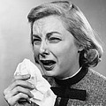 Woman Sneezing by H. Armstrong Roberts/ClassicStock